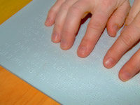 Photo of someone reading Braille