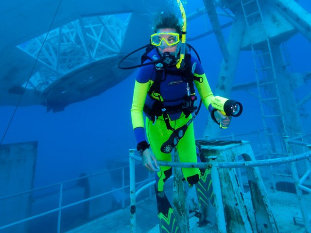 Diver Jaclyn Skafas explores the superstructure of the Gen. Hoyt S. Vandenberg artificial reef in the Florida Keys National Marine Sanctuary off Key West, Fla. Friday, May 29, 2009. After a dramatic May 27 scuttling, the Vandenberg opened to the public Saturday, May 30. The hull of the vessel rests on the sandy bottom in about 145 feet of water, but the 523-foot-long former U.S. Air Force missile tracking ship is so massive that its superstructure begins just 45 feet below the sea surface. (Stephen Frink/Florida Keys News Bureau/HO)