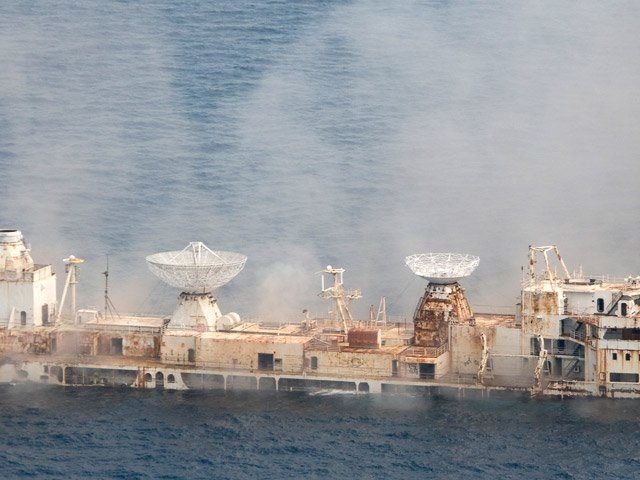 In this photo released by the Florida Keys News Bureau, the former U.S. Air Force missile-tracking ship Gen. Hoyt S. Vandenberg begins to sink after cutting charges were detonated Wednesday. May 27, 2009, seven miles off Key West, Fla. The 523-foot-long Vandenberg, that played a key role in the Cold War and tracked NASA spacecraft launches in the 1960s, 70s and early 80s, was scuttled to create an artificial reef to attract recreational divers and anglers. It sank in less then two minutes. (Andy Newman/Florida Keys News Bureau/HO)