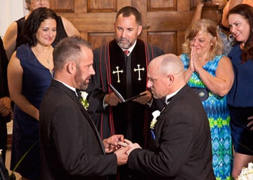 With Rev. Steve Torrence, center, officiating, Aaron Huntsman, front left, and William Lee Jones, front right, completed their wedding vows on the steps of the Monroe County Courthouse Jan. 6, 2015, in Key West. The couple were the first same-sex couple to be married legally in the Florida Keys.