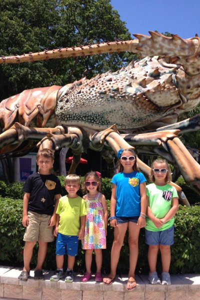 Kids with public sculpture