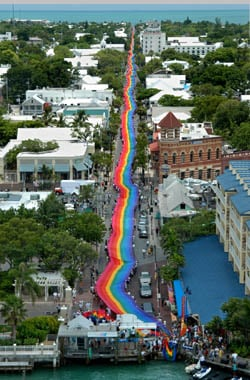 On June 15, 2003, Gilbert Baker's 1.25-mile-long rainbow flag was unfurled down Duval Street from the Gulf of Mexico to the Atlantic Ocean in a sea-to-sea proclamation of pride and diversity. (Photo by Andy Newman/Florida Keys News Bureau)