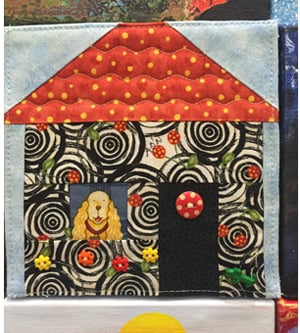 One of the mural's panels even displays a whimsical fabric-art home with a dog in the window. (Photo by Elizabeth Young, Florida Keys Council on the Arts)