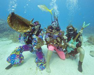 Costumed divers Underwater Music Festival