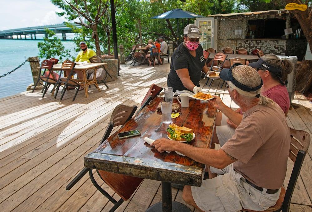 Waitress serves visitors Islamorada Keys reopen