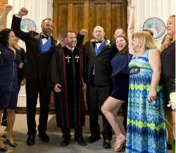 Aaron (second from left) and Lee (fourth from right) cheer with their supporters after being declared legally married in Key West. (Photo by Carol Tedesco, Florida Keys News Bureau)