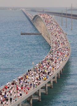 "A field of 1,500 runners crosses the ""hump"" of the Seven Mile Bridge near Marathon during a past Seven Mile Bridge Run. (Photo by Andy Newman, Florida Keys News Bureau)"