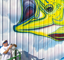 artist painting dolphin mural Florida Keys