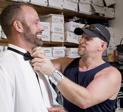 Lee (right) adjusts Aaron's bowtie during their tux fitting before the wedding. Lee's shackle bracelet encircles his left wrist. (Photo by Rob O'Neal, Florida Keys News Bureau)