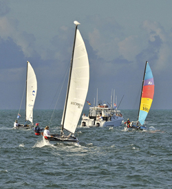 Three of the five American Hobie Cats, accompanied by a support boat, jockey for position on their historic race to Havana. (Photo by Bert Budde, Florida Keys News Bureau)