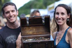 Win a treasure chest filled with silver dollars during Mel Fisher Days -- like this lucky couple did in 2014. (Photo courtesy of Mel Fisher's Treasures)
