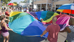 Celebrants wave a circular rainbow flag on Duval Street in Key West following a ruling by the U.S. Supreme Court that same-sex couples have the right to marry nationwide. (Photo by Rob O'Neal, Florida Keys News Bureau)
