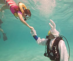 Underwater Easter bunny and kid diver