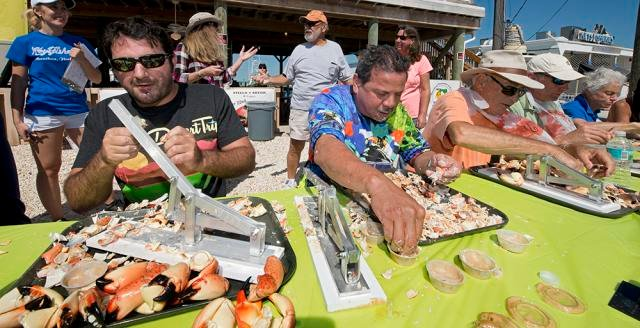 Competitors crack and consume 25 stone crab claws, picking them clean, in the fastest time. Images: Andy Newman