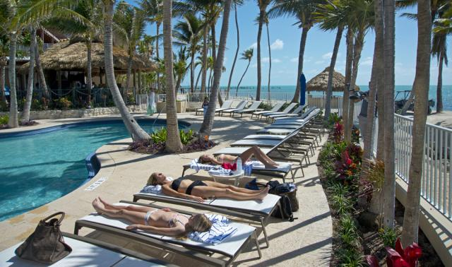 Visitors enjoy the pool at Cheeca Lodge Resort & Spa, when the iconic Florida Keys resort reopened Friday, March 30, 2018. Image: Andy Newman