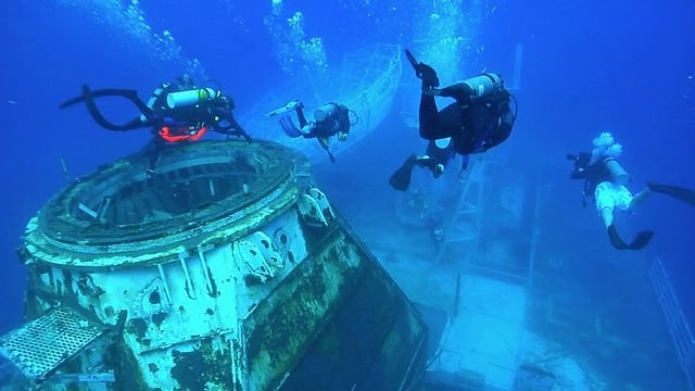 Structures used to create artificial reefs, such as the Gen. Hoyt S. Vandenberg, intentionally sunk in the Florida Keys National Marine Sanctuary.