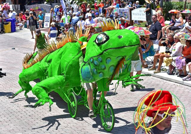 Cayman Smith-Martin pedals his 30-foot-long iguana, with spines made from scrap cardboard, during the 2019 Papio Kinetic Sculpture Parade. Images: Rob O'Neal