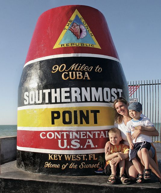 Cuba is often on visitors' minds as they snap selfies at another local landmark: the red, black and yellow Southernmost Point marker.