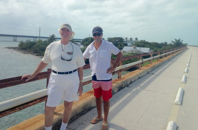 McKinnon and a visiting childhood friend on the the Old Seven Mile Bridge, set to reopen to pedestrians and visitors for recreational activities and trolley service to the island by March 2022.