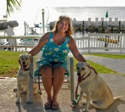 Amy Slate at Amoray Dive Resort, with her Lab retrievers, Mia and Tia. Photo by Peter Lorber