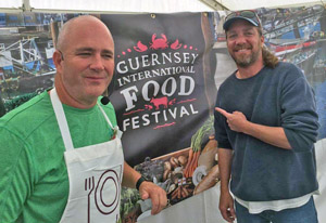 Niedenthal, alongside fellow chef and Key Largo restaurateur, Bobby Stoky, at a food festival in Guernsey in the British Channel Islands.
