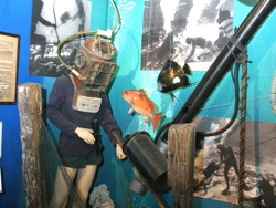 "Today, the museum contains artifacts and ephemera covering 4,000 years of diving history. Highlights include an exhibit of dive helmets from around the world, and one dedicated to Upper Keys treasure hunter Art ""Silver Bar"" McKee."