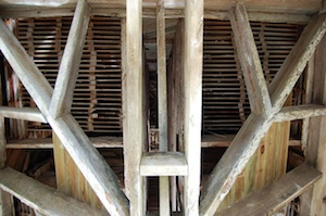 Looking up, inside the singled pine tower.