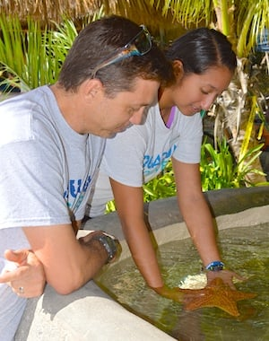 Kids of all ages enjoy the touch tanks with starfish and other critters at Florida Keys Aquarium Encounters.
