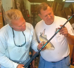 Legendary angler Roland Martin, left, examines a swordfish rod that Berry fabricated.