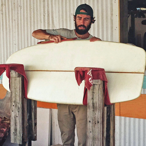 "An innovative ""craftsman by the sea,"" Kearins puts some touches on a hand shaped custom cruising board."