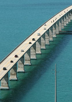 Image 1 traffic rolls on the seven mile bridge tuesday after it