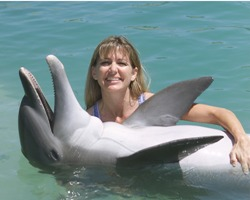 Cheryl Messenger cradles a most cooperative dolphin for a photo opportunity. (Photos courtesy of Dolphin Connection)