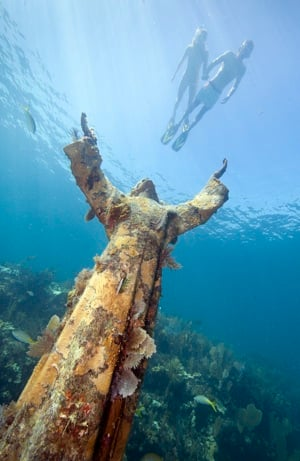 "The iconic nine-foot-high ""Christ of the Deep,"" a 4,000-pound bronze statue installed as an underwater shrine is located inside the Florida Keys National Marine Sanctuary. Image by Stephen Frink"