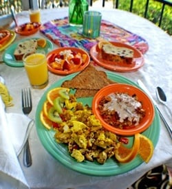 At breakfast, guests at the small Caribbean-style inn can savor vegetarian feasts of home-baked breads and fruits, organic and sourced locally, and the kitchen serves only organic fair trade coffee and tea.
