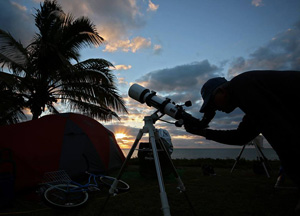 Greg Bragg aims his telescope during the 2016 Winter Star Party on Scout Key, where more than 600 amateur and professional astronomers view the heavens.