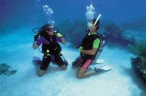 Kids as young as 10 years old can learn to be junior scuba divers, offering families the opportunity learn a new sport and gain a lifetime of diving fun, adventure and memories. Image courtesy of Hall's Diving Center.