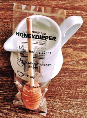 Keez Beez products include a honey dipper or swizzle stick for dissolving honey in hot beverages.