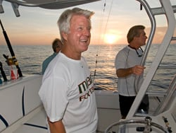 Former NFL and University of Miami football coach Jimmy Johnson and friends head off of Islamorada at sunrise for a day of fishing, July 14, 2011. Photos by Andy Newman/Florida Keys News Bureau