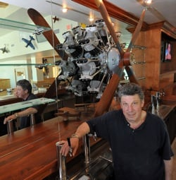 Behind the long bar is a replica 1927 engine that Richmond commissioned, and nearby is an exact model of the plane his father flew in wartime.