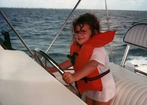 A then-five-year-old Lowe plays captain for the day on the water with her family.