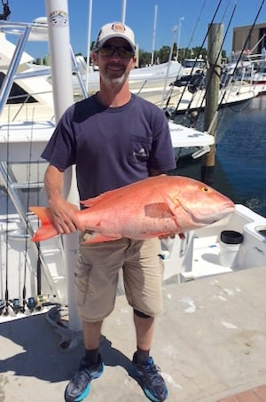 Matt Paganelli shows off one of his snapper catches in the 2016 challenge.