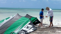 Mike teaches a young kiteboarding student shoreside.