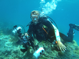"A shot caught of Rob as he's shooting his own pictures at Molasses Reef during a ""day off."""