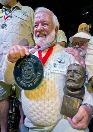 "Charlie Boice beams after winning the 2015 ""Papa"" Hemingway Look-Alike Contest at Sloppy Joe's Bar. Boice finally won the contest after trying for 15 years. Images: Andy Newman"