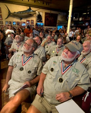"Previous winners of the ""Papa"" Hemingway Look-Alike Contest, including Fred Johnson, front left, and Denny Woods, front right, intently watch the 2010 finalists."