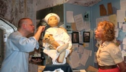 Two paranormal experts examine Robert the Doll.