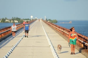 Middle Keys residents favor a sunrise walk across a landmark 2.2-mile section of the old Seven Mile Bridge open to pedestrians and bicyclists.