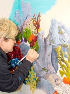 Cook is completing a mural inside Marathon's hospital, alongside four other area artists.