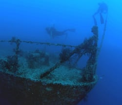 Divers swim on the shipwreck  Spiegel Grove which sunk on its side in 2002 and then was righted by Hurricane Dennis in 2005. Photo by Fraser Nivens/Florida Keys News Bureau