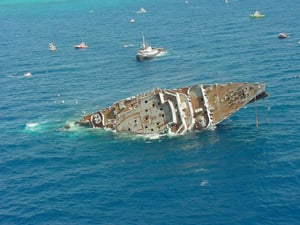 On May 17, 2002, Spiegel Grove unexpectedly sank prematurely and rolled over about six hours before its intended scuttling, leaving its upside-down bow protruding above the surface of the water.